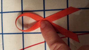 "Orange ribbons are a symbol to wear that we demand an end to ""The New Jim Crow"" by ""Michelle Alexander"" and an end to ""mass incarceration."""